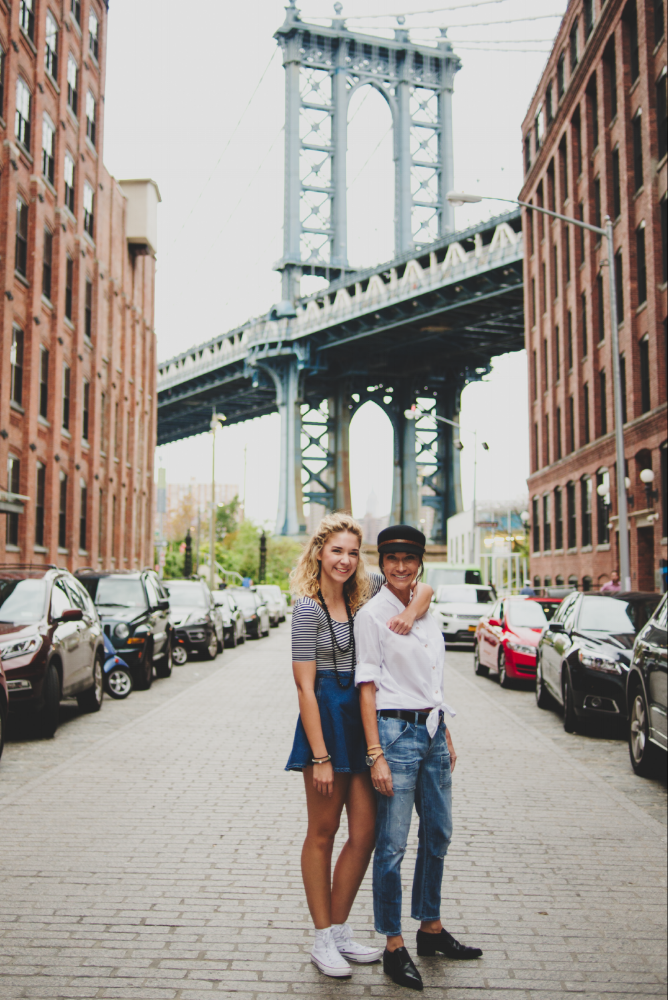 Mother and Daughter smiling with the Brooklyn bridge in the background in New York City, USA