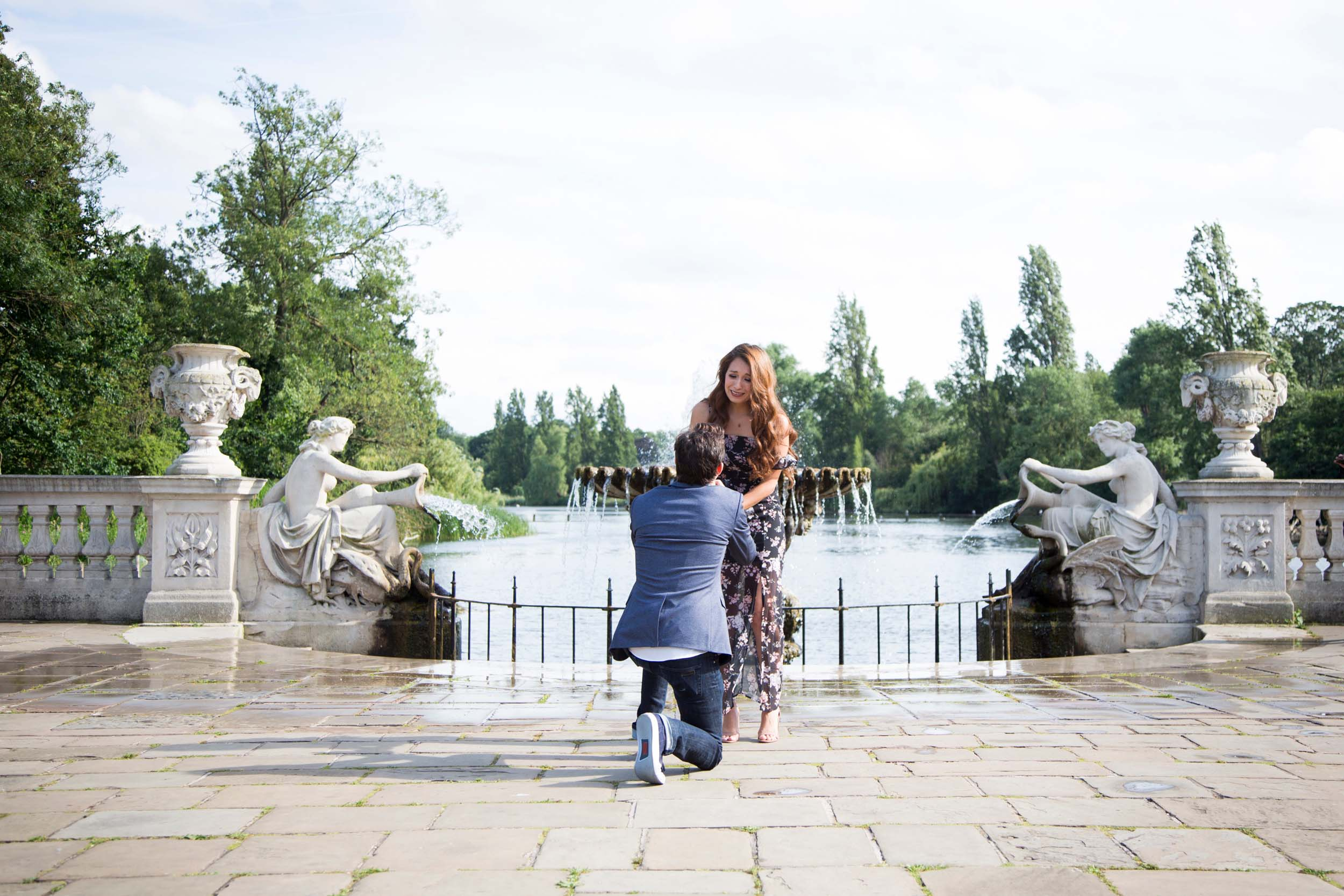 Woman shocked by her surprise proposal while her partner is proposing in London, UK