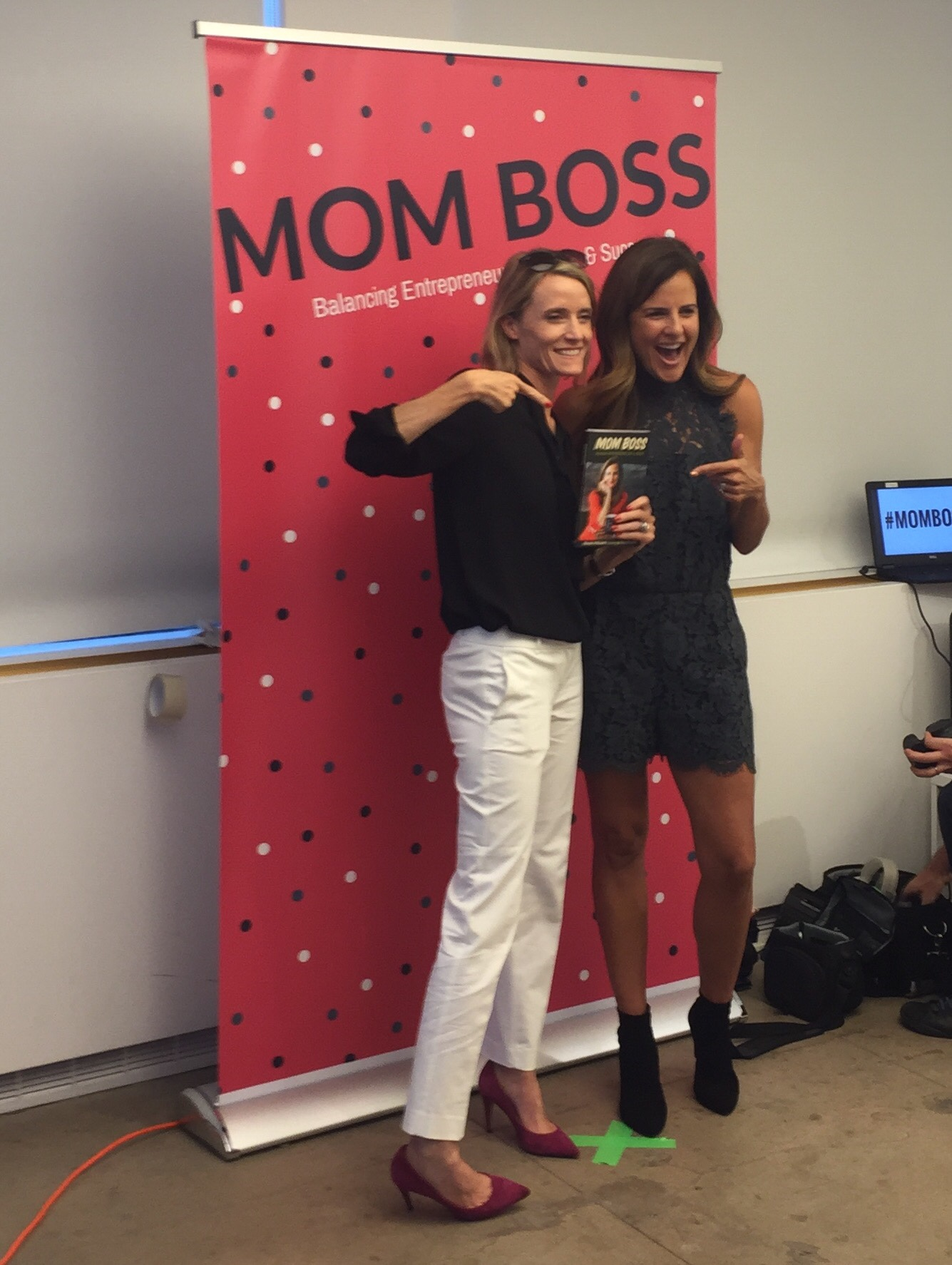 Carley Roney and Mom Boss author Nicole Feliciano pose at the book launch party.