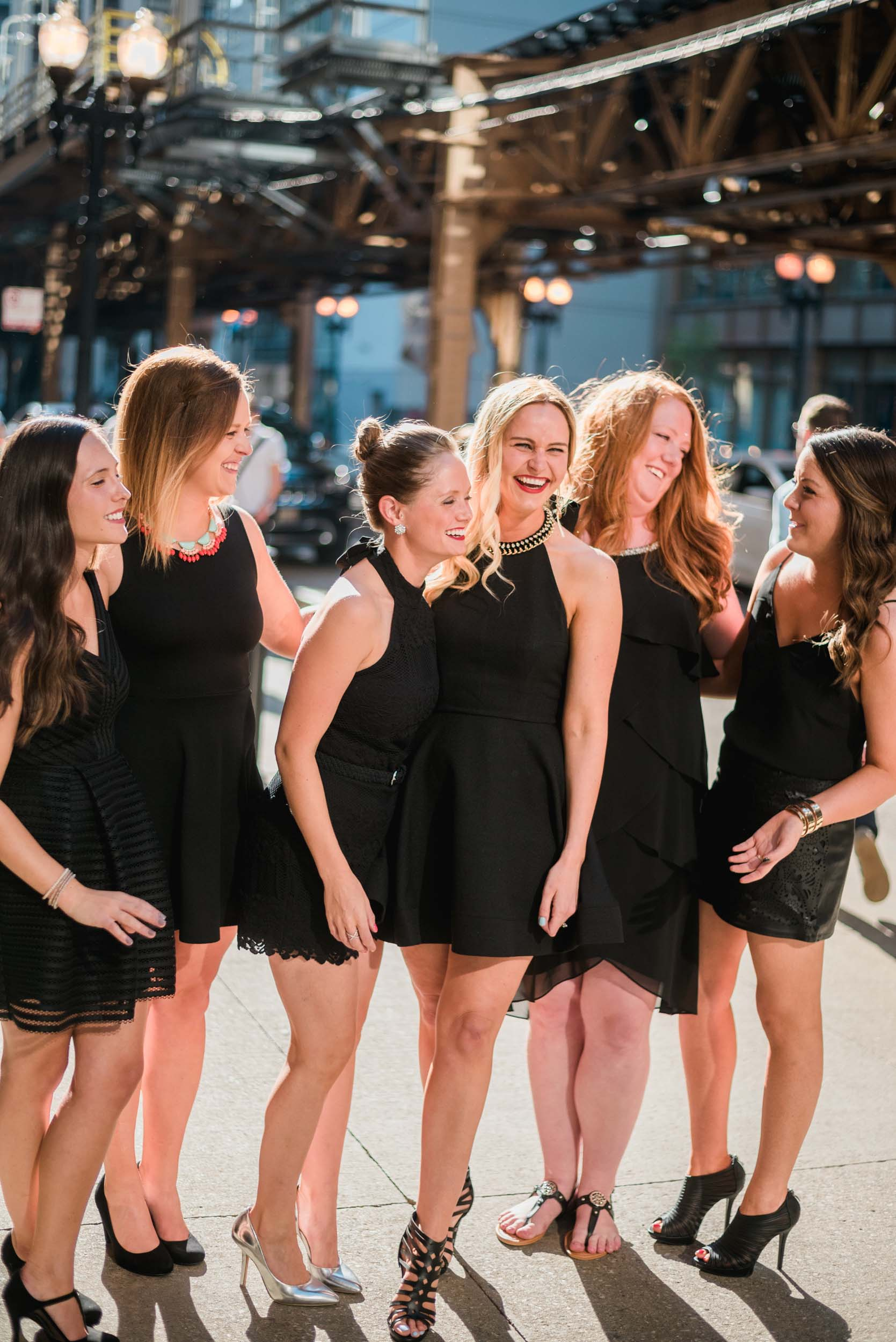 Six female friends on a bachelorette trip laughing together in Chicago, USA