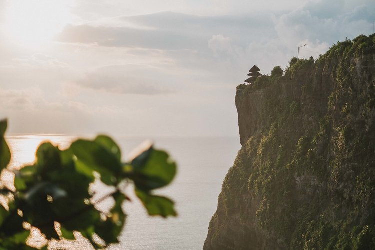 Uluwatu Temple perched upon a cliff in Bali, Indonesia