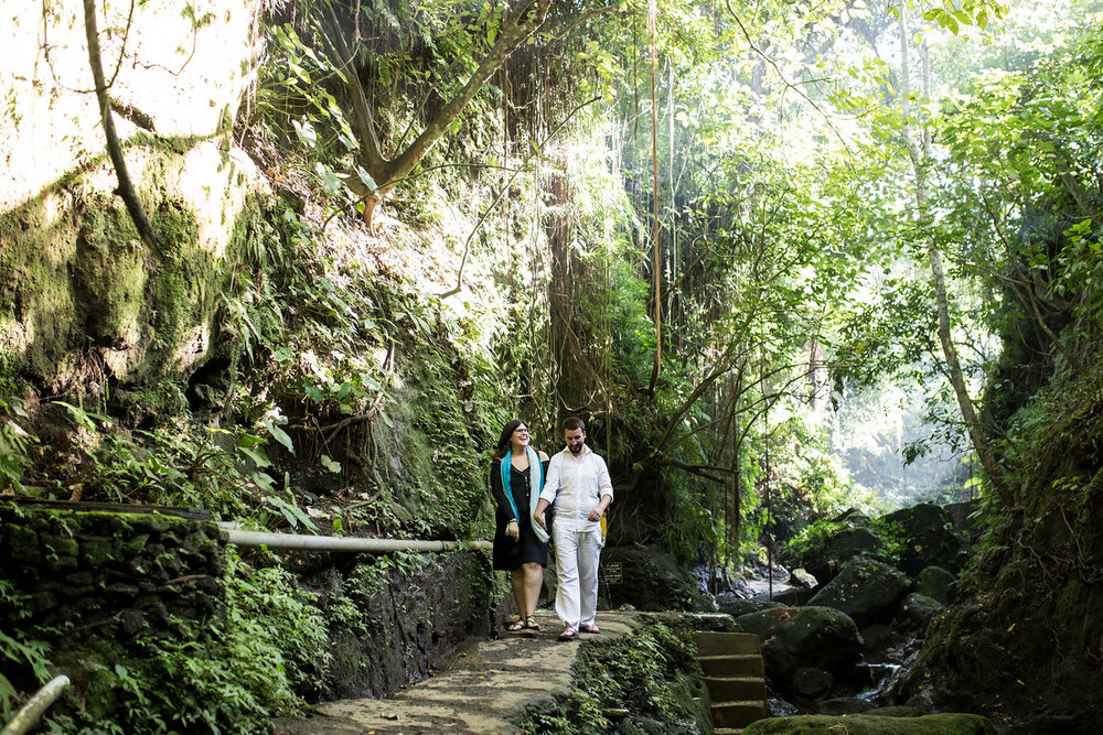 Couple walking along pathway in the Monkey Forest in Bali, Indonesia