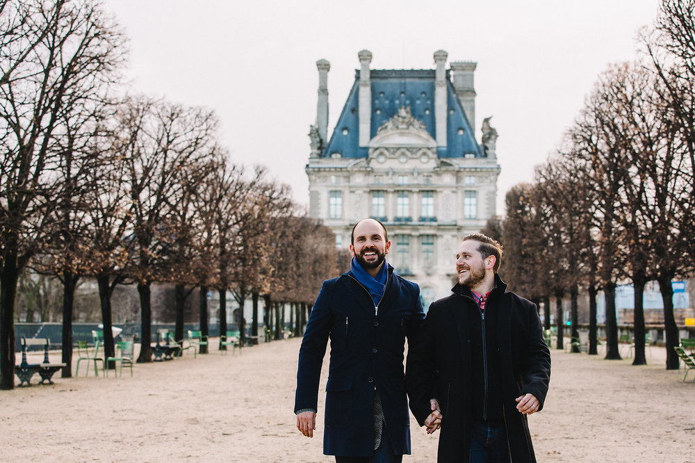 LGBTQ+ couple holding hands and walking together in Paris, France