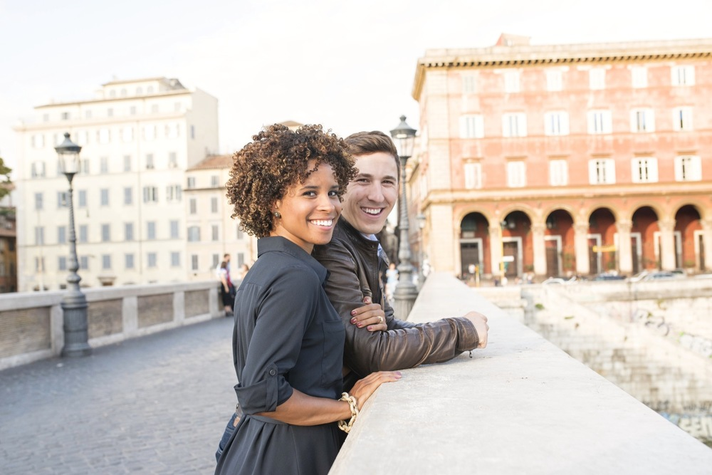 Couple standing together and looking at the camera in Rome, Italy