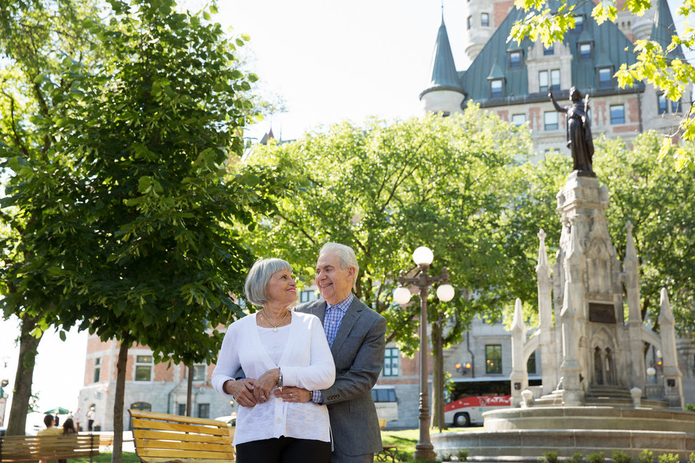 Mature couple holding each other in a park in Quebec City, Quebec Canada