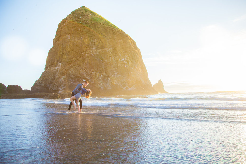 Couple dancing together in the water at Cannon Beach in Portland, Oregon USA