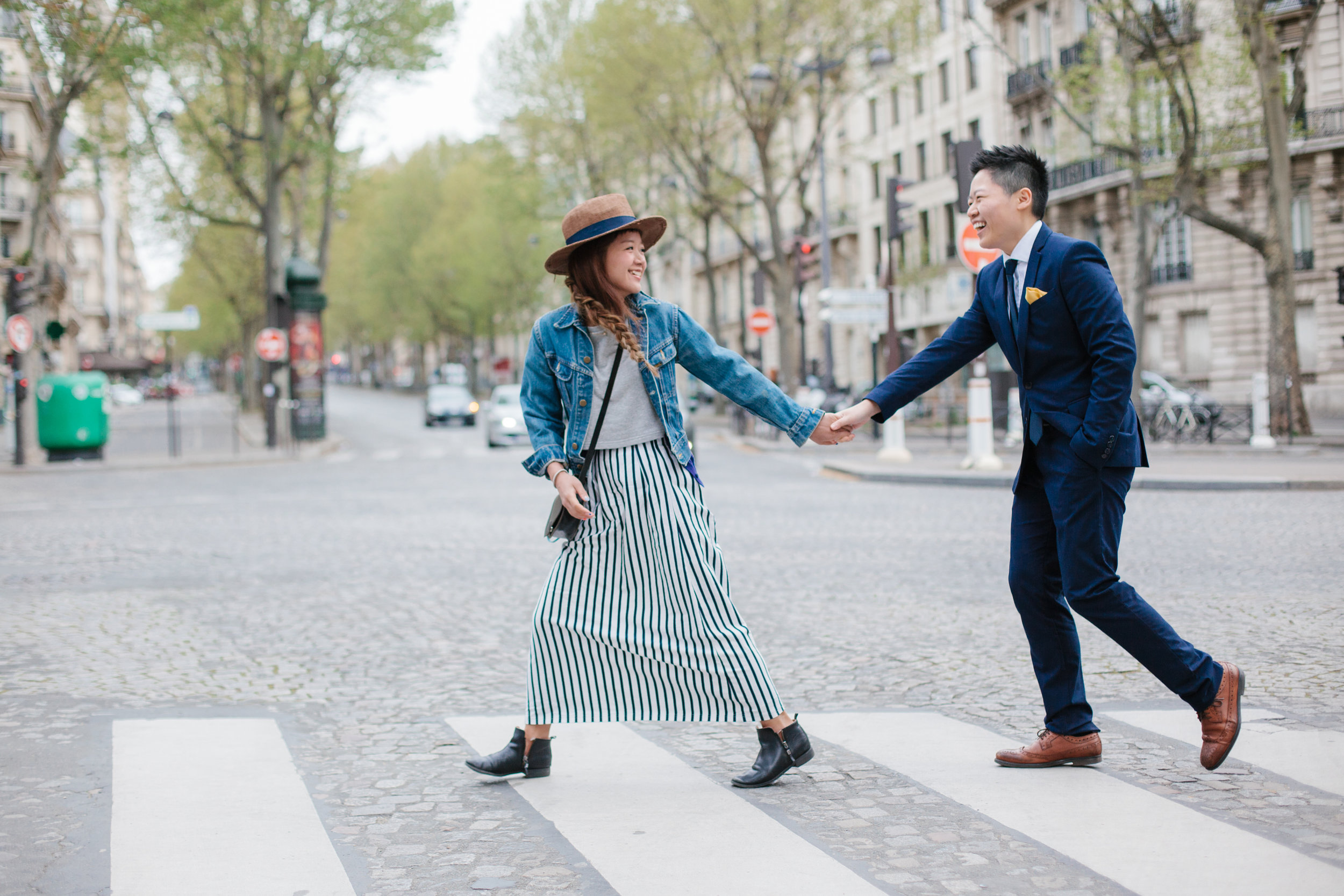 Couple crossing the street on a couples trip in Paris, France