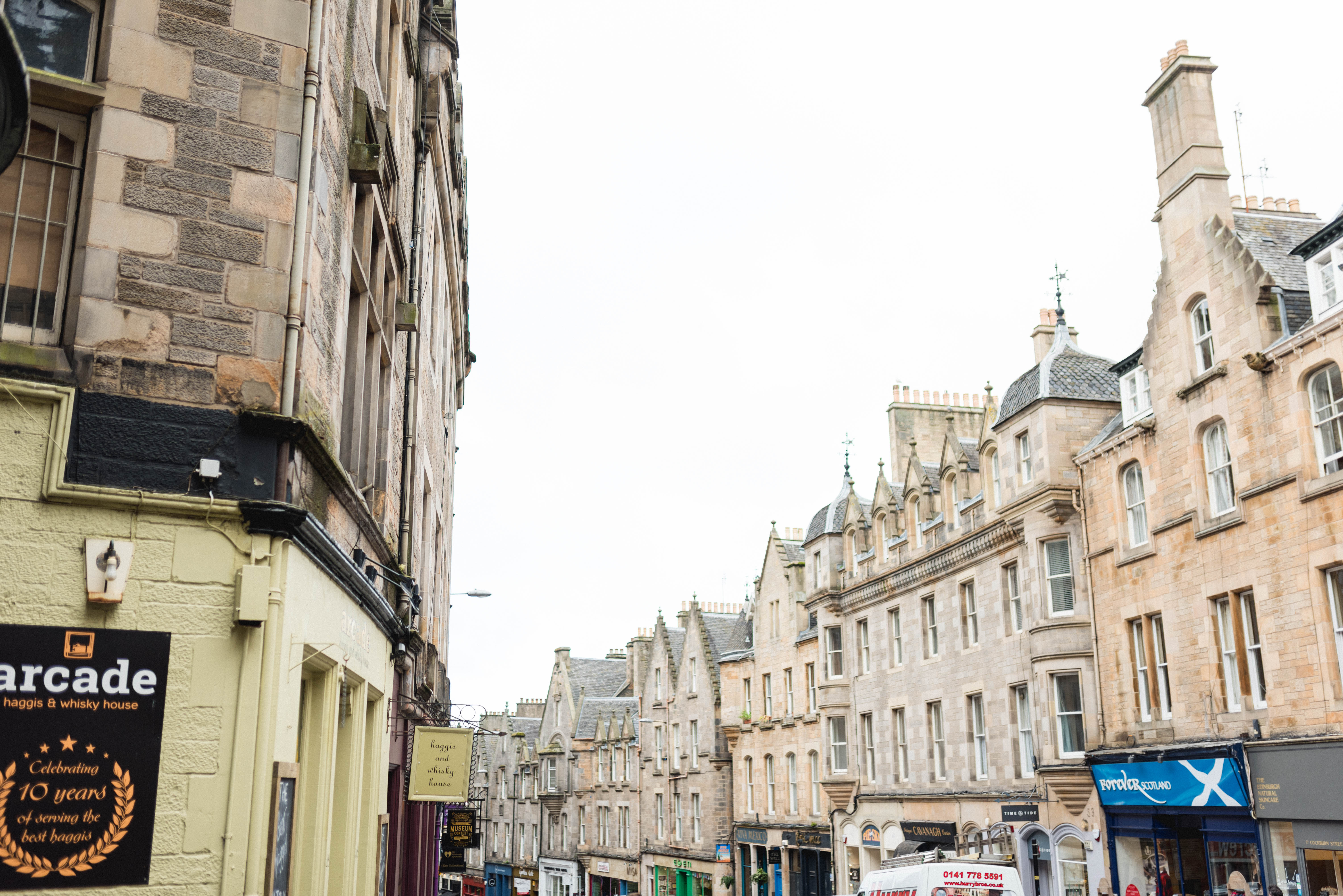 The streets of downtown Edinburgh, a city that dates back to the 1300s, are legendary. (Photo: Flytographer Jilly in Edinburgh, Scotland)