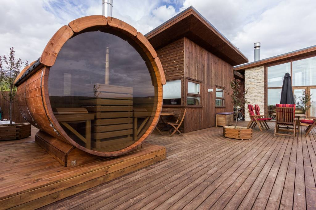 You can see the cool glass and wood sauna on the deck of this luxury Iceland villa. (Photo: Courtesy Airbnb)
